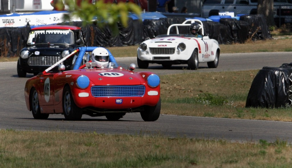 Mark Derry leaving turn 5 with Wiertz closing in from behind in his Roadster